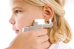 Ear piercing with Studex System75 — hygienic and barely noticeable